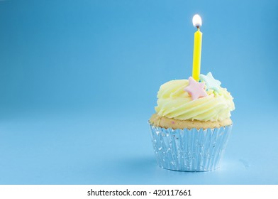 Cup cake with birthday candle light