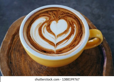 Cup of cappuccino with beautiful latte art on Wooden plate. Morning coffee for couple in love, Hot coffee, Top view.
