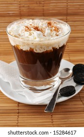 Cup of cappuccino with cacao and sugar