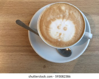 Cup of cappuccino with cat face design