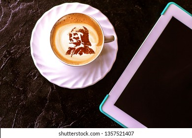 a cup of cappuccino coffee on May 4 with a pattern of a star lord