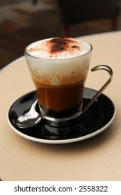Cup of cappuccino coffee on a restaurant table