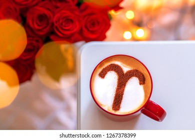 a cup of cappuccino coffee with a zodiac sign pattern of cinnamon aries on milk froth