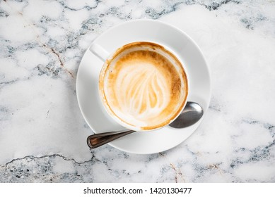 cup of cappuccino on the marble background