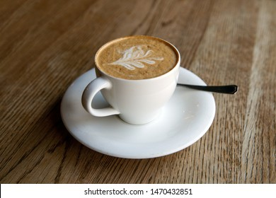 A cup of cappuccino on table