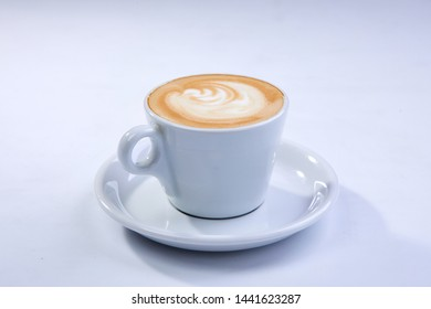 cup of cappuccino on the white