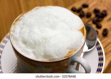 Cup of Cappuccino on the wooden Background