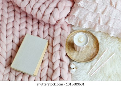 Cup with cappuccino, pink pastel giant plaid, fur, bedroom, morning concept