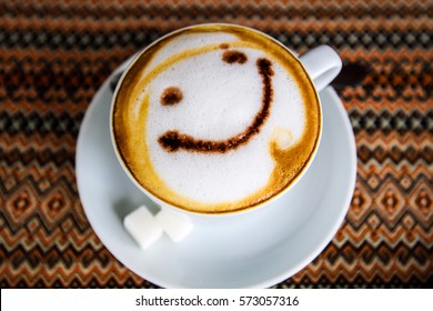 "Cup of cappuccino with ""smile"" sign"
