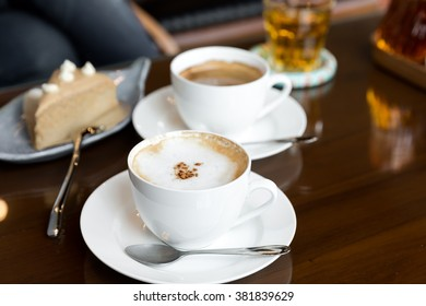 A cup of cappuccino topped with cacao powder