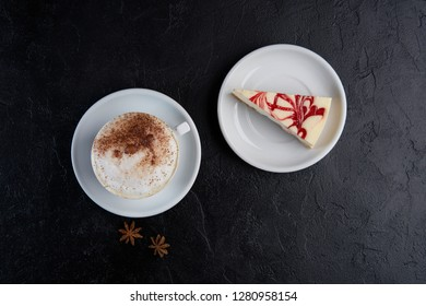 Cup of cappuchino coffee with cheese cake. Copy space, top view, flat lay