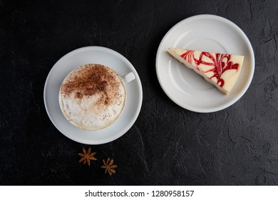 Cup of cappuchino coffee with cheesecake. Copy space, top view, flat lay