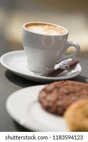 Cup of cappucino and biscuits
