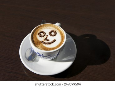 A cup of cappucino coffee, delicious morning drink, cup of morning coffee, Cup with coffee lather in blurry background, morning cup of cappucino, morning coffee