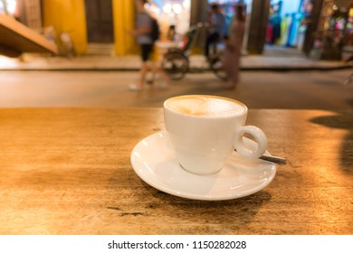 A cup of capuchino coffee in night. Royalty high quality free stock image of a cup of capuchino coffee in a coffee shop. Drink coffee is the habit of many people