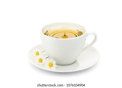 cup of chamomile with splashing drop and daisy on white background