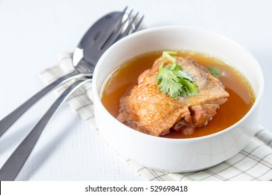 cup of chicken soup with Chinese herbs