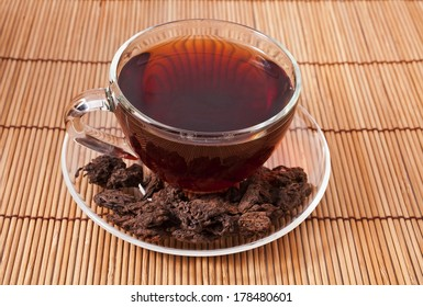 The cup of the chinese pu-erh tea