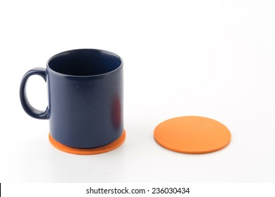 cup and coaster on white background