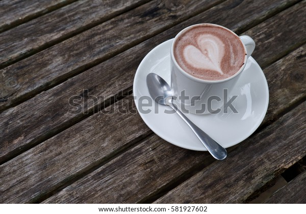 Cup of cocoa with heart icon on