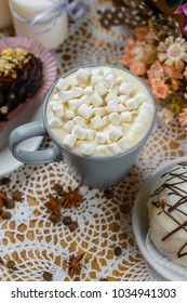 Cup of Cocoa with marshmallow on table in cafeteria