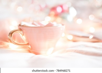 Cup of cofee with marshmallow over lights background close up. Good morning.