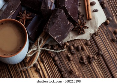 cup of cofee with milk.dark chocolate with cinnamon, coffe bean and star anise