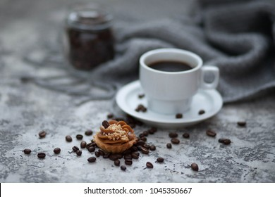 cup of cofee and sweet cupcake