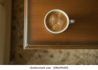 Cup of coffe on wooden table