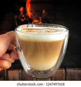 cup of coffee against fireplace