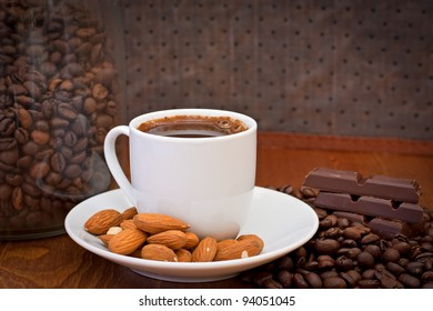 cup of coffee, almonds and chocolate