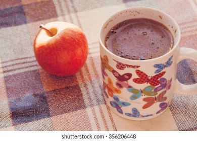 Cup of coffee and apple