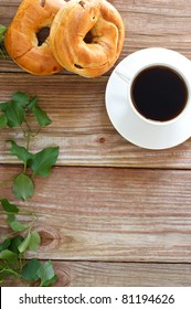 Cup of Coffee with Bagels on Wooden Table