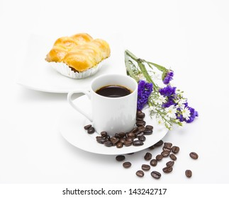 A cup of coffee and a bakery on white background.