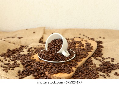 A cup and coffee beans