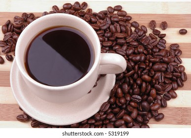 a cup of coffee with beans as background