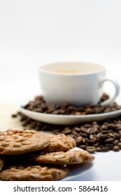 cup of coffee with beans and cookies