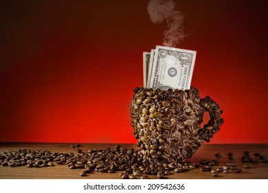 Cup of coffee beans and dollars, Made a coffee cup with coffee beans, Real photo, not 3D render. Smoke made with adobe photoshop cs6.