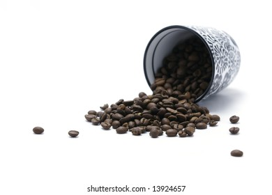 Cup and coffee beans - focus on beans