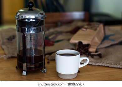 cup of coffee, beans and french press