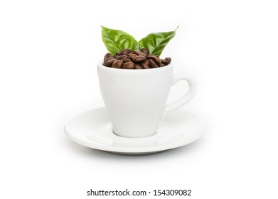 cup of coffee with coffee beans and coffee leaf isolated  on a white background