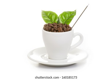 cup of coffee with coffee beans and coffee leaf on a white background