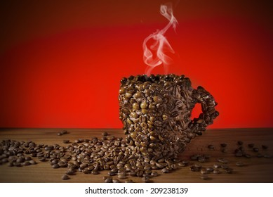 Cup of coffee beans, Made a coffee cup with coffee beans, Real photo, not 3D render. Smoke made with adobe photoshop cs6.