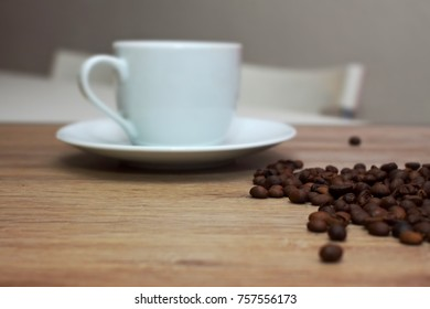 cup of coffee with coffee beans table