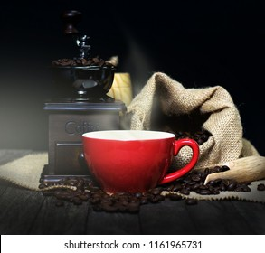 A cup of coffee and coffee beans with traditional coffee machines.
