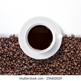 Cup of coffee and coffee beans with white area for copy space.