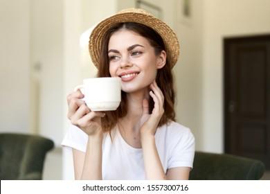 Cup of coffee beautiful woman headdress smile