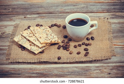 A cup of coffee and biscuits in a vintage style