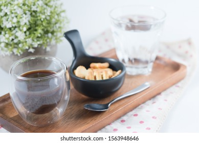 Cup of coffee with biscuits and water