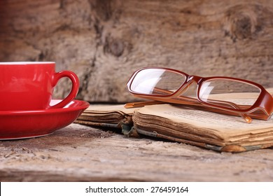 A Cup of coffee. Breakfast. A lover of literature. Reading, Hobbies. Literary criticism, writing. To write books. Search inspiration. Knowledge. Information. Library. Glasses on the book.